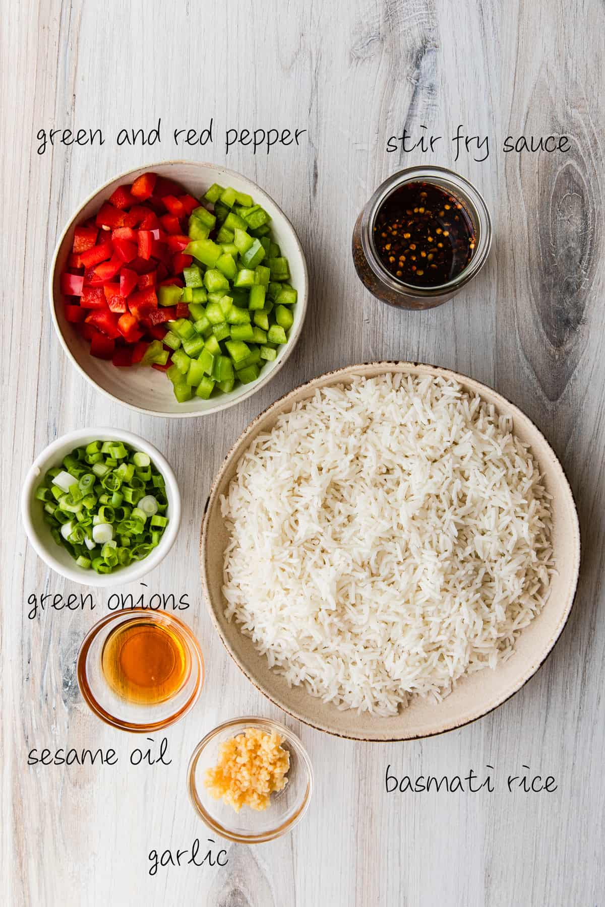 rice, green and red peppers, green onions, sesame oil, garlic, spices