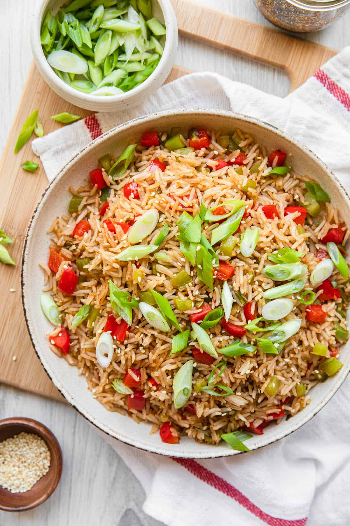 a bowl of fried rice and green onions