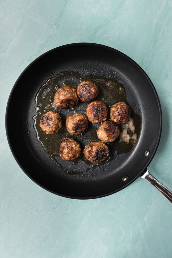 Meatballs in a fry pan.