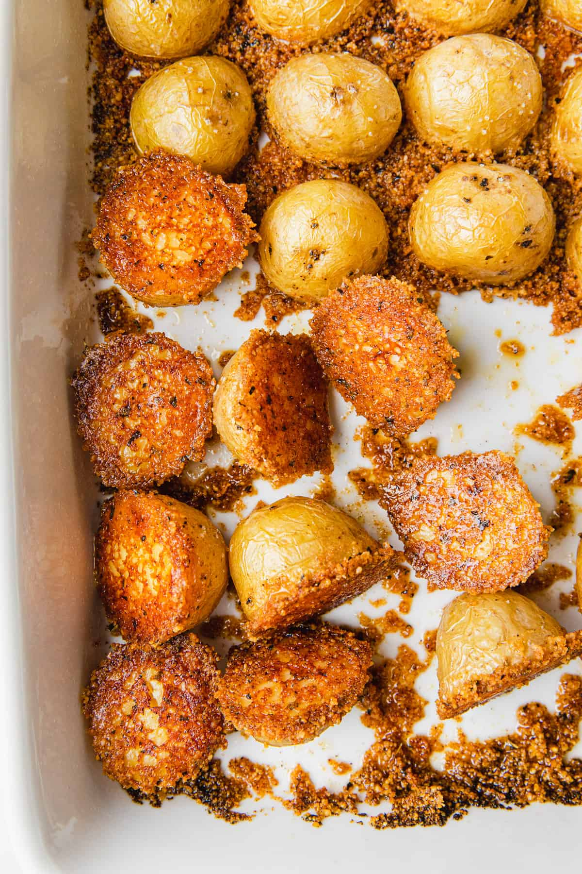 Cooked potatoes flipped over in a baking dish.