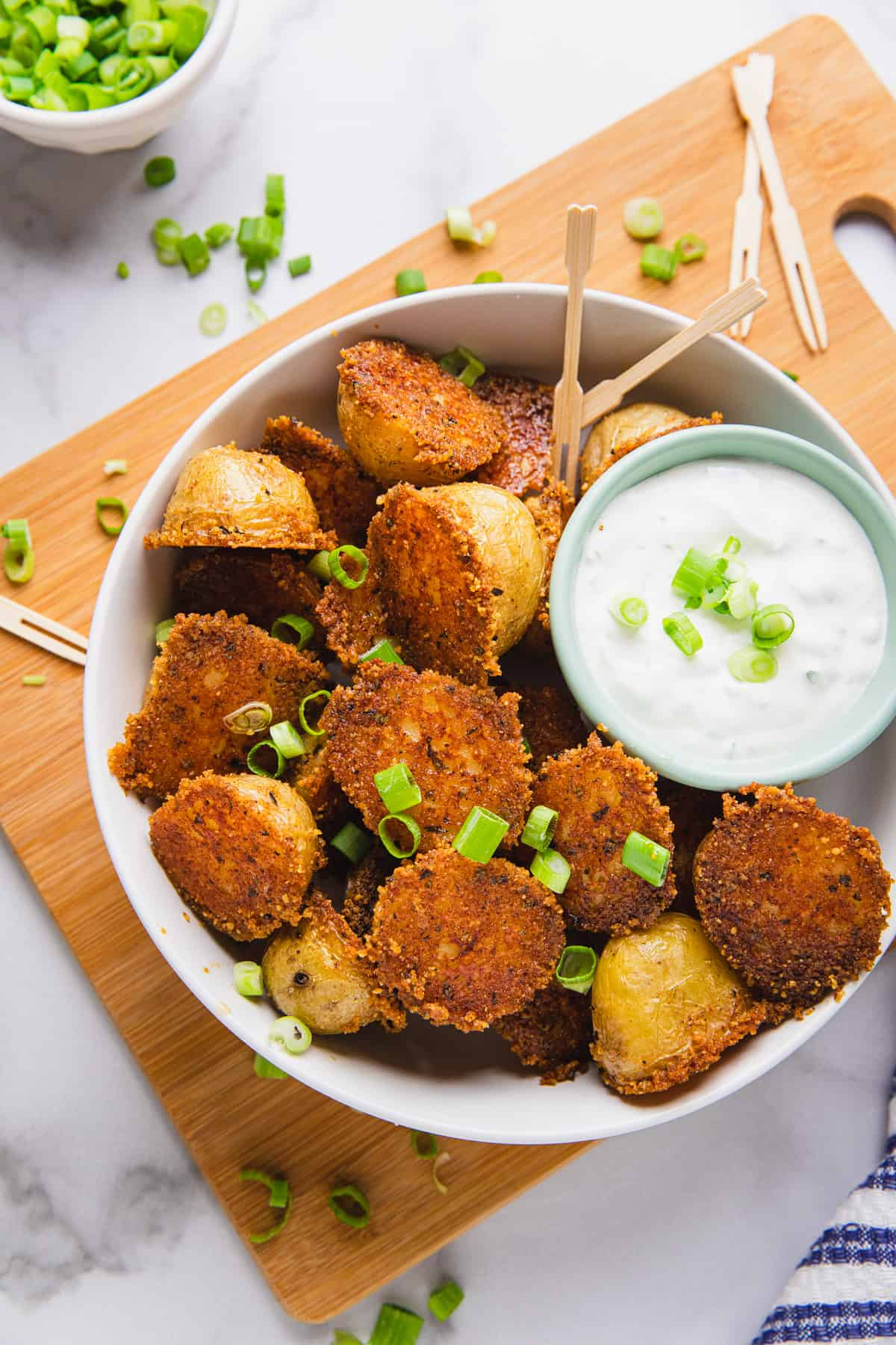 cooked potatoes in a bowl with dipping sauce