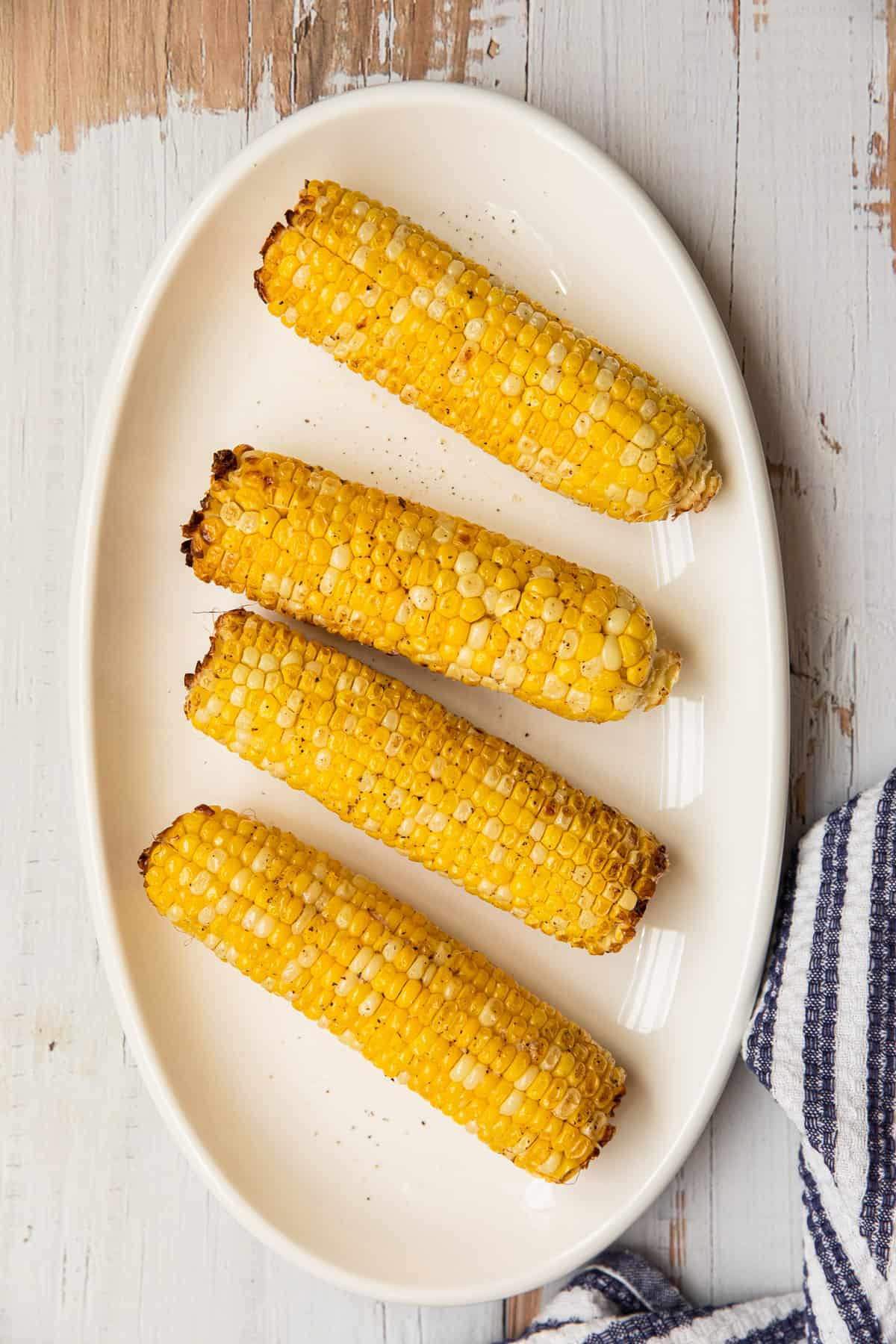 a platter with corn on the cob