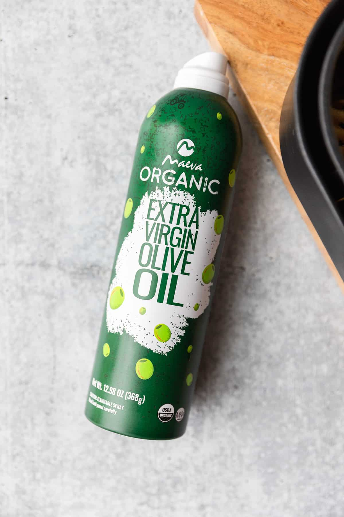 a can of extra virgin olive oil spray