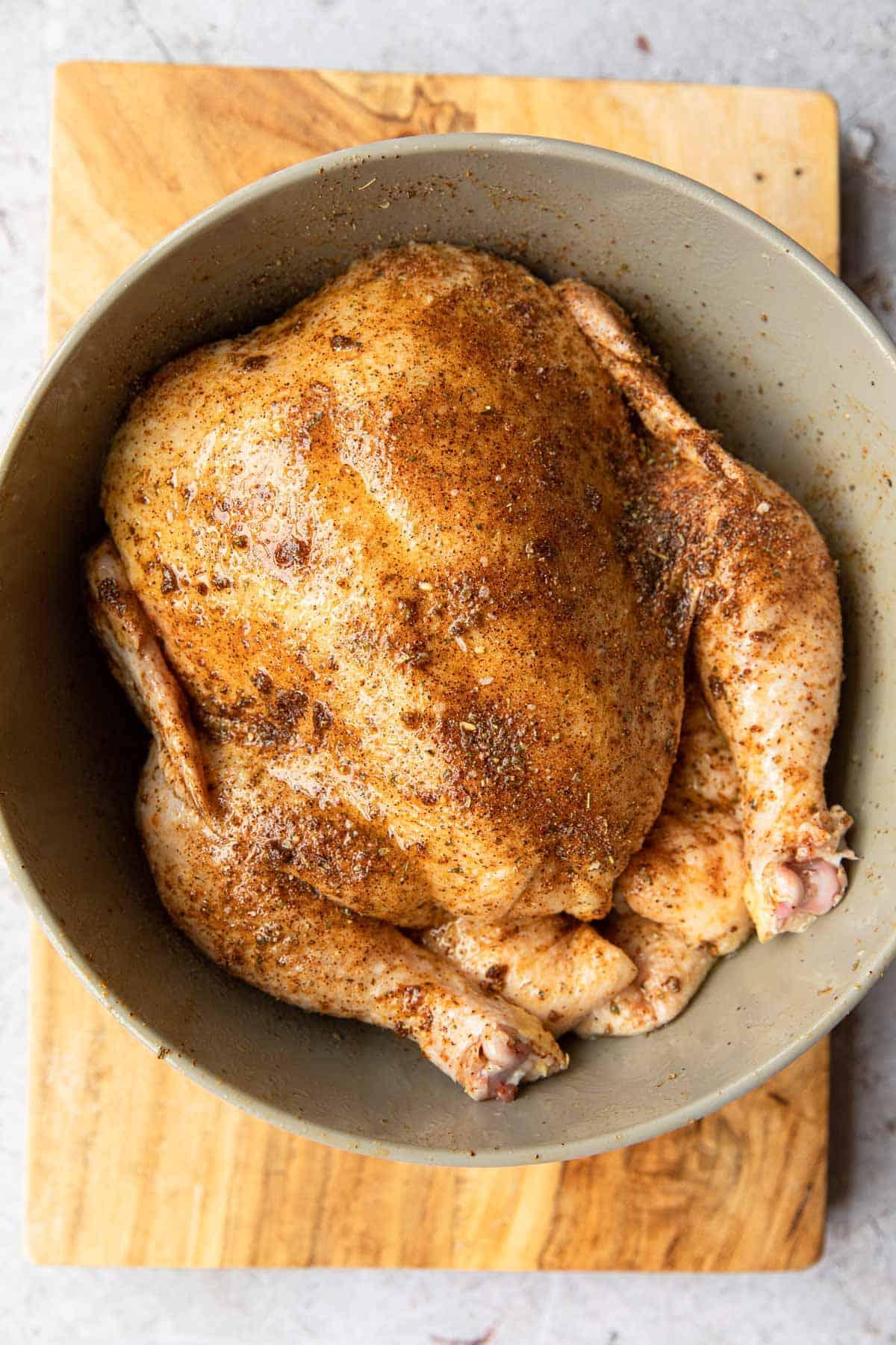 raw seasoned whole chicken