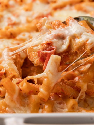 a pan of baked pasta in a red sauce