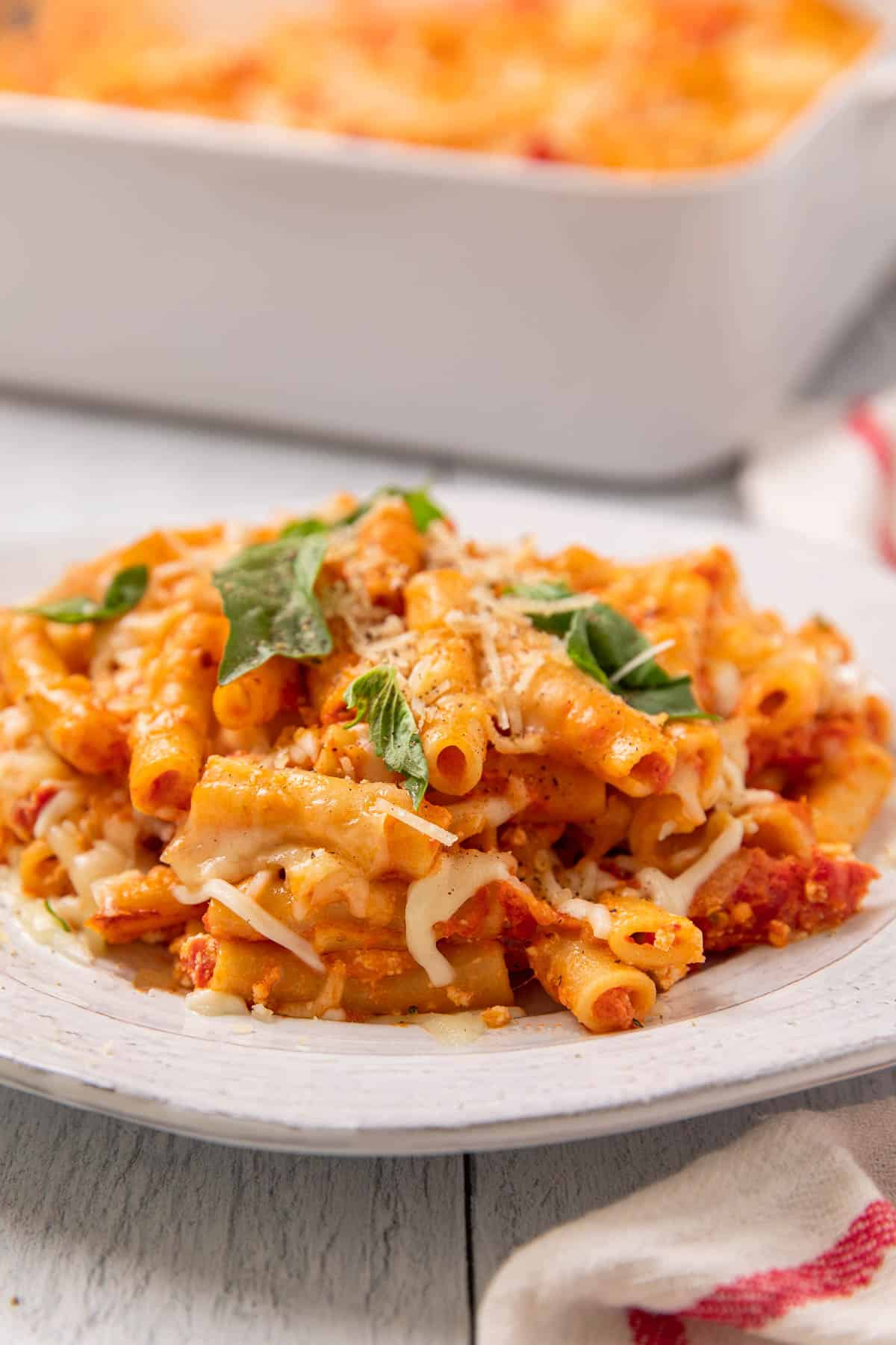 a plate of baked pasta with red sauce