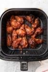 cooked wings in fryer basket