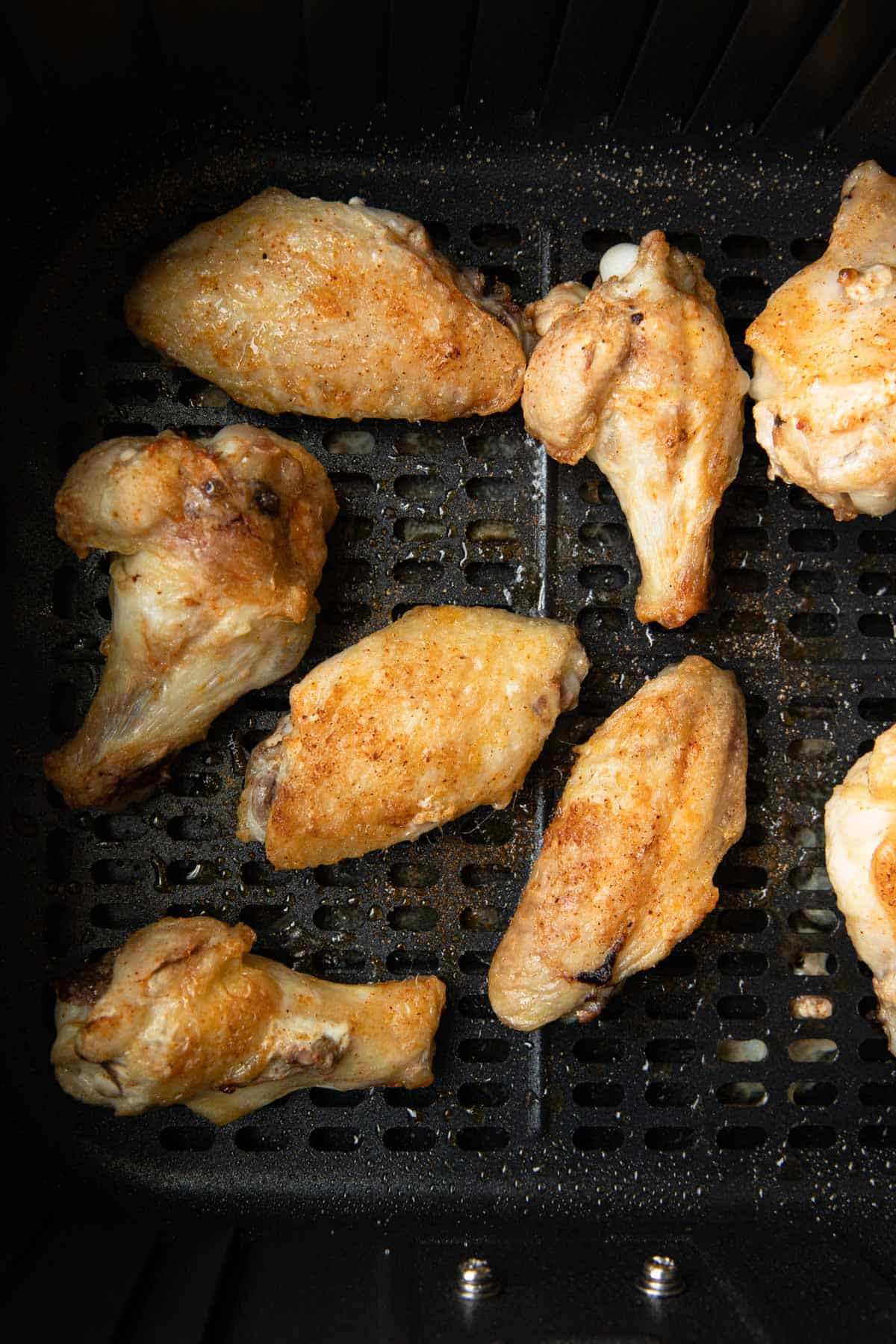 cooked unsauced chicken wings in bakset